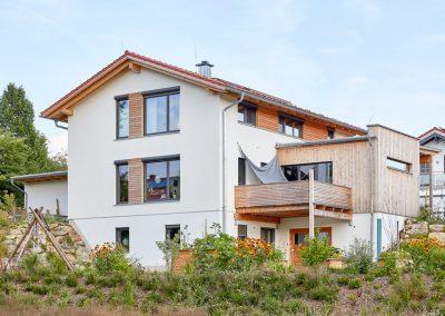 Vollholzhaus Satteldach verputzt beplankt